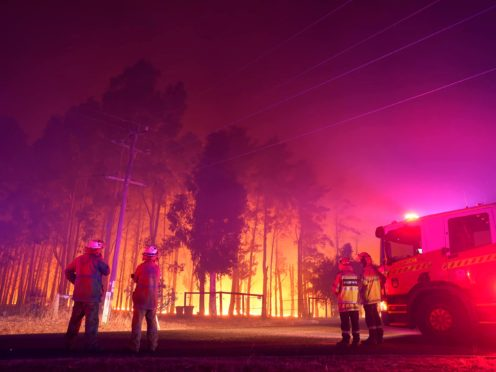 Firefighters attend a blaze near Perth (Evan Collis/DFES via AP)