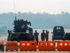 Myanmar's military stand guard at a checkpoint (AP Photo)