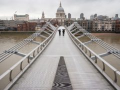 An almost deserted Millennium Bridge near St Paul's Cathedral in central London during England's third national lockdown (Dominic Lipinski/PA)