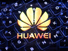 File photo dated 08/02/20 of an in camera multiple exposure photograph showing the Huawei logo and the keys of a keyboard. PA/ Dominic Lipinski