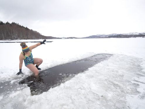 Alice Goodridge, from Newtonmore, swims in Loch Insh, in the Cairngorms National Park (Jane Barlow/PA)