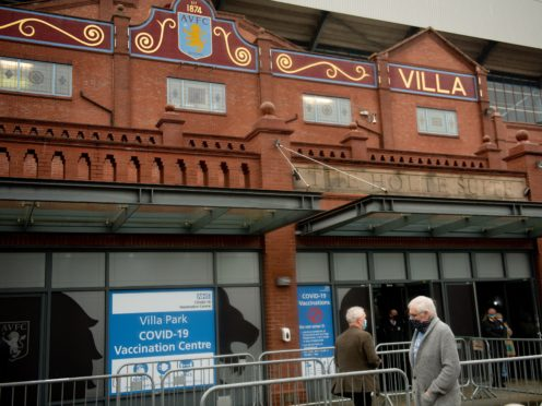 People arrive at a new seven-day vaccination hub at Villa Park, in Birmingham, the home of Premier League club Aston Villa (Jacob King/PA)