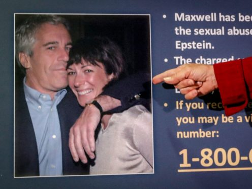 A prosecutor points to a picture of Jeffrey Epstein and Ghislaine Maxwell (John Minchillo/AP)