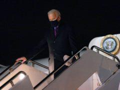 President Joe Biden steps off Air Force One at New Castle Airport in Delaware on Friday (Patrick Semansky/AP)