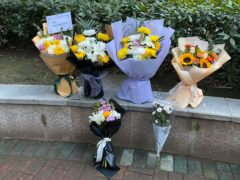 Floral tributes outside Wuhan Central Hospital (Ng Han Guan/AP)