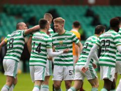 Stephen Welsh (centre) scores his first goal for Celtic (Jane Barlow/PA)