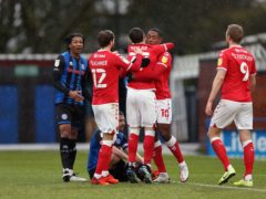 Chuks Aneke (second right) celebrates scoring the opening goal against Rochdale (Barrington Coombs/PA)