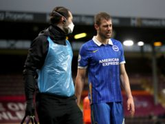 Adam Webster hobbled off in pain after rolling his ankle in Brighton's draw at Burnley (Molly Darlington/PA)