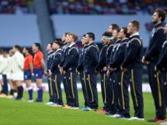 Scotland players standing ahead of their clash with England (David Davies/PA)