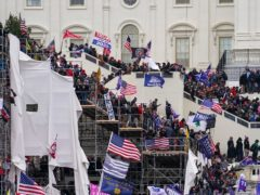 Rioters storm the US Capitol in Washington on January 6 (John Minchillo/AP)