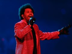 The Weeknd enlisted a small army of lookalikes for a glittering Super Bowl half-time show packed with hits (AP Photo/Chris Carlson)