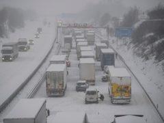 Vehicles stuck in a traffic jam in snowfall in Germany (Robert Michael/dpa via AP)