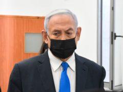 Israeli Prime Minister Benjamin Netanyahu arrives for a hearing at the district court in Jerusalem (Reuven Castro/Pool/AP)