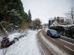 Abandoned cars in a snow-filled ditch in Needham Market in Suffolk (Joe Giddens/PA)