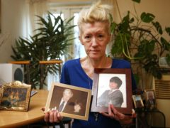 Jasna Badzak holding pictures of her son Sven Badzak who was murdered in north west London on February 6 (Jonathan Brady/PA)