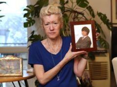 Jasna Badzak holds a photo of her son taken in 2014 (Jonathan Brady/PA)