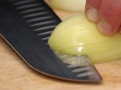 A general view of an onion being cut (Tim Goode/PA)