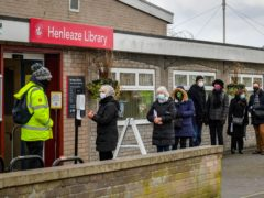 People wait in line for a coronavirus test (Ben Birchall/PA)