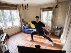 Alex Beardmore conducts a fencing class using Zoom in his living room at his home in Hitchin, Hertfordshire (Kirsty O'Connor/PA)