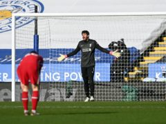 Liverpool goalkeeper Alisson (right) stands dejected after an error (Michael Regan/PA)