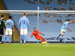 Manchester City's Rodri (right) opens the scoring against Tottenham from the penalty spot (Shaun Botterill/PA)