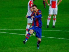 Lionel Messi celebrates after scoring his side's second goal against Alaves (Joan Monfort/AP)