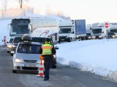 Cars and lorries from the Czech Republic wait to enter Germany (Sebastian Kahnert/dpa via AP)