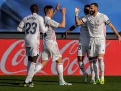Karim Benzema (right) was on the scoresheet as Real Madrid won 2-0 against Valencia (Manu Fernandez/AP)