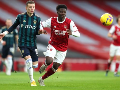 Arsenal's Bukayo Saka (right) says Mikel Arteta's is selecting the perfect mix of Arsenal youth and experience.