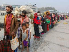 Rohingya refugees headed to the Bhasan Char island prepare to board navy vessels from the south eastern port city of Chattogram, Bangladesh (AP)