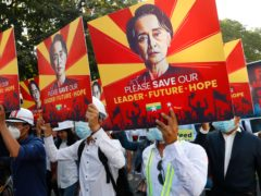 Engineers hold posters with an image of deposed Myanmar leader Aung San Suu Kyi as they hold an anti-coup protest march in Mandalay (AP Photo)