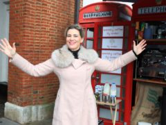 Lily Deluca, from Sao Paolo, who has found her calling during the Covid-19 pandemic after turning a red phone box into a mini coffee kiosk on Tunsgate in Guildford, Surrey (Adam Davy/PA)