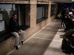 Rapper Pablo Hasel sits inside the University of Lleida (Joan Mateu/AP)