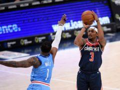 Washington's Bradley Beal shoots against Houston Rockets guard John Wall during the Wizards' win on Monday night (Nick Wass/AP)