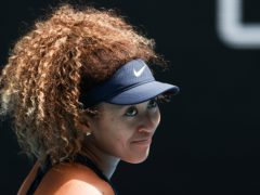 Naomi Osaka reacts after defeating Hsieh Su-wei to set up a clash with Serena Williams (Hamish Blair/AP)