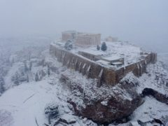 Snow covers the ancient Acropolis hill in Athens (Antonis Nikolopoulos/Eurokinissi via AP)