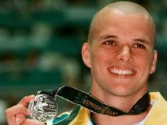 Scott Miller of Australia holds his silver medal that he won in the men's 100 metre butterfly at the 1996 Summer Olympics in Atlanta (Denis Paquin/AP)