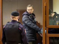 Russian opposition leader Alexei Navalny, centre, appears in court (Babuskinsky District Court Press Service via AP)