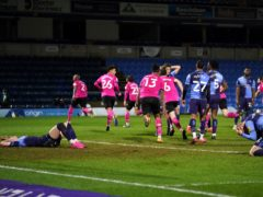 Derby celebrate as Andre Wisdom, far left, scores in stoppage time to leave Wycombe dejected (John Walton/PA)