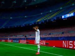 Kylian Mbappe scored a superb hat-trick at Nou Camp (Joan Monfort/AP)