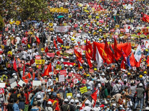 Demonstrators gather in an intersection close to Sule Pagoda to protest against the military coup in Yangon, Myanmar (AP)