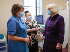 The Duchess of Cornwall speaks with members of staff during a visit to the Queen Elizabeth Hospital in Birmingham (Molly Darlington/PA)