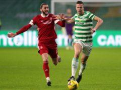 Kristoffer Ajer, right, battling with Aberdeen striker Fraser Hornby (Andrew Milligan/PA)