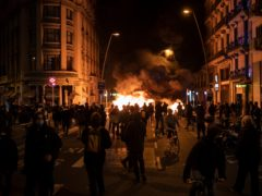 Protesters gather by a burning barricade in Barcelona (Felipe Dana/AP)