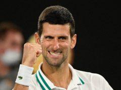 Novak Djokovic is all smiles after beating Aslan Karatsev (Andy Brownbill/AP)