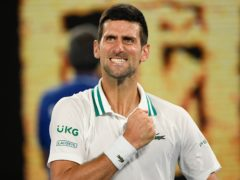 Novak Djokovic celebrates after defeating Aslan Karatsev (Andy Brownbill/AP)