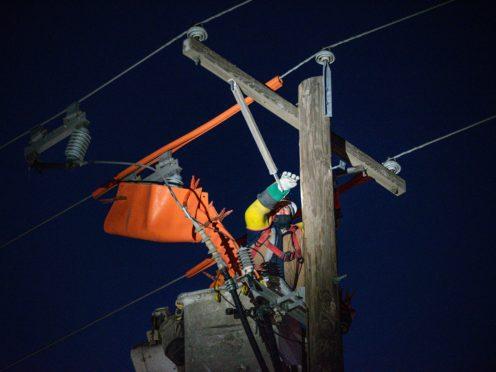 Power lines under repair in Texas (Odessa American/AP)