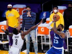 Los Angeles Lakers forward LeBron James, right, shoots over Jeff Green (Marcio Jose Sanchez/AP)