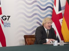 Prime Minister Boris Johnson in the Cabinet Room, Downing Street, hosting the G7 leaders for a virtual meeting (Geoff Pugh/Daily Telegraph/PA)