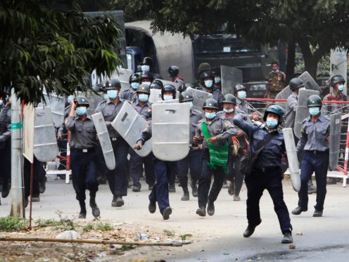 Police charge forward to disperse protesters in Mandalay, Myanmar (AP)